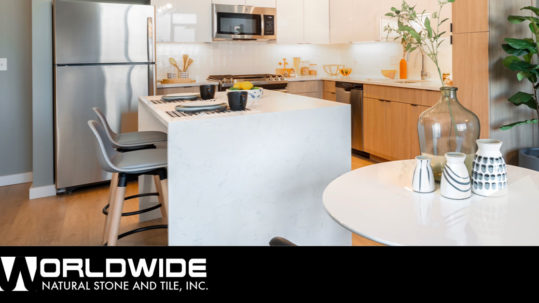 Carrara Quartz Countertops paired with natural wood & white cabinets